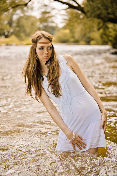 Young Hippie Woman standing in a River Adult Fashion Lifestyle Nature Relaxing Scenic Summertime Woman Beauty In Nature Germany Hippie Hippielife Hippy Long Hair Model Outdoor Posing River Sky Water Woman Of EyeEm women around the world Young Adult Young Women