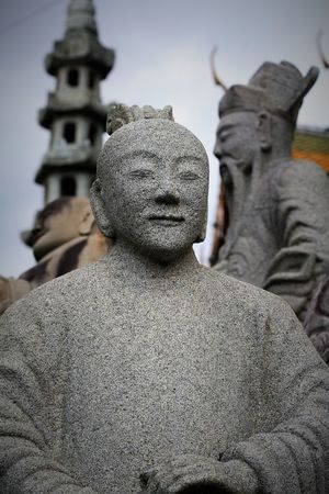 Ancient Chinese style stone sculpture in Wat Suthat Thepwanaram Bangkok, Thailand. Thailand Photos Wat Suthat Ancient Architecture Art And Craft Chinese Style Close-up Day Focus On Foreground Human Representation Male Likeness No People Outdoors Sculpture Sky Statue Travel Destinations