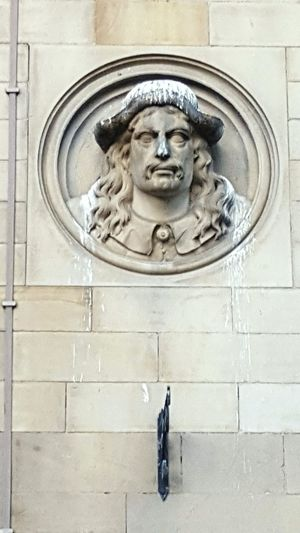 Low angle view of statue in front of door