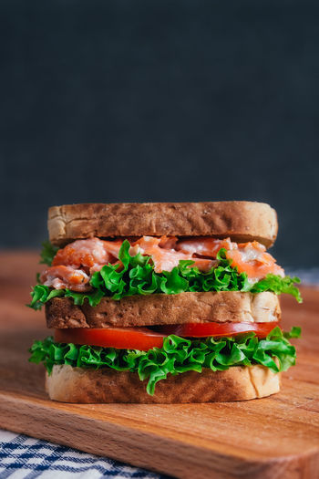 Bread Burger Close-up Cutting Board Day Fast Food Food Food And Drink Freshness Indoors  Lettuce Meat Minced No People Ready-to-eat Salmon Salmon Sandwich Sandwich Studio Shot Tomato