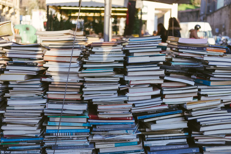 Stack of books for sale at market stall
