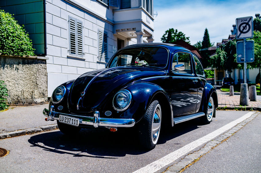 Architecture Beetle Blue Building Building Exterior Built Structure City City Life City Street Day Käfer Land Vehicle Mode Of Transport No People Outdoors Parked Parking Road Sky Stationary Street Volkswagen VW VW Beetle VW Käfer