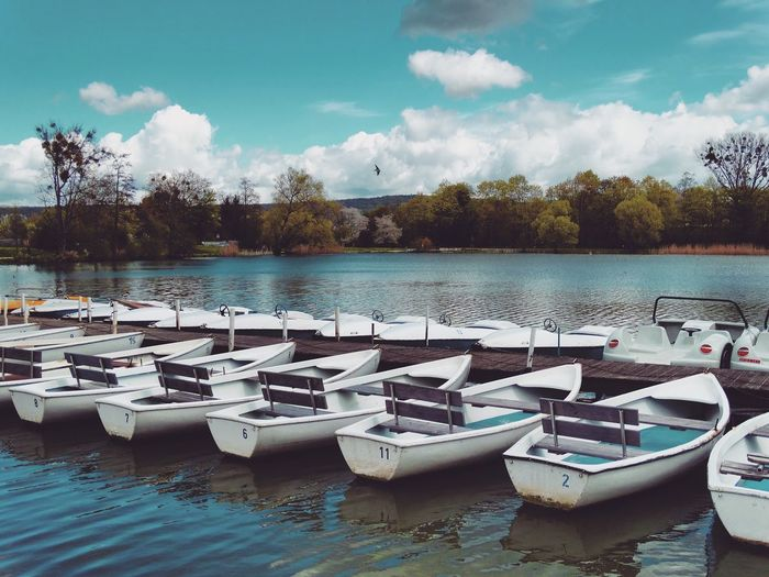 Boats Moored At Dock In Lake