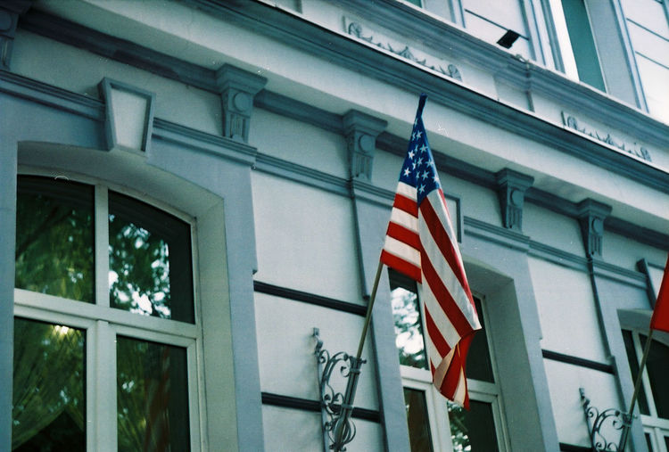 Low angle view of flags on building