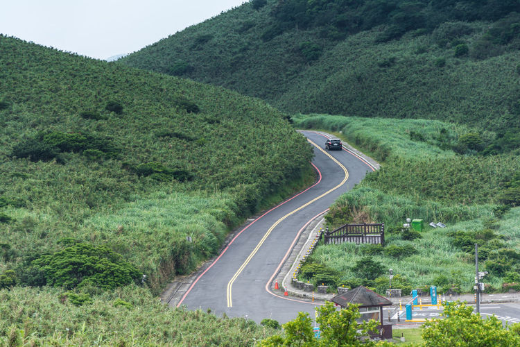 Road Transportation Plant Tree Car Motor Vehicle Mode Of Transportation Day Nature High Angle View No People Curve Mountain Land Vehicle Environment Landscape Green Color Land Outdoors Scenics - Nature