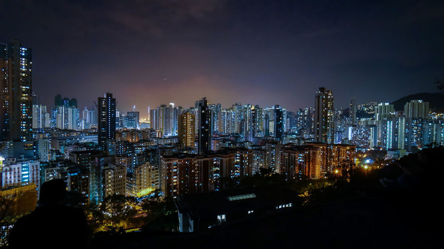 Sham Shui Po in Hong Kong. Building Exterior Built Structure City Night Architecture Building Illuminated Cityscape Skyscraper Office Building Exterior Sky Tall - High Urban Skyline Tower Modern Residential District Office Landscape City Life Nature No People Financial District  Outdoors Nightlife Spire