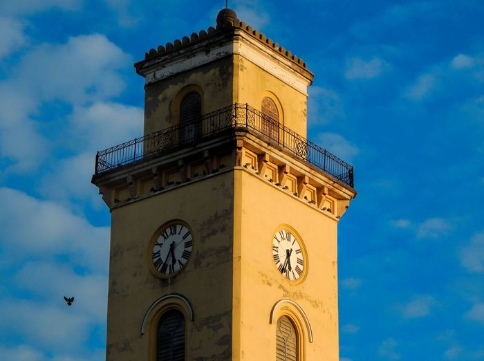 Clock tower of a lutheran church in sunset's lights Architecture Bell Tower Blue Building Exterior Built Structure Clock Clock Face Clock Tower Cloud - Sky Day Low Angle View No People Outdoors Sky Time The Architect - 2018 EyeEm Awards
