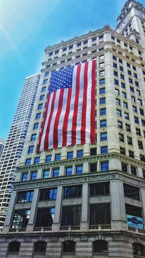 Patriotism Flag Architecture Low Angle View Government Politics And Government No People Building Exterior Blue Outdoors Day Sky Riverside Chicago Downtown Chicago Photographer Chicago Architecture Chicago ♥ Chicago Skyscraper Architecture Chicago, Illinois Chicago River Chicago Skyline Chicagoshots