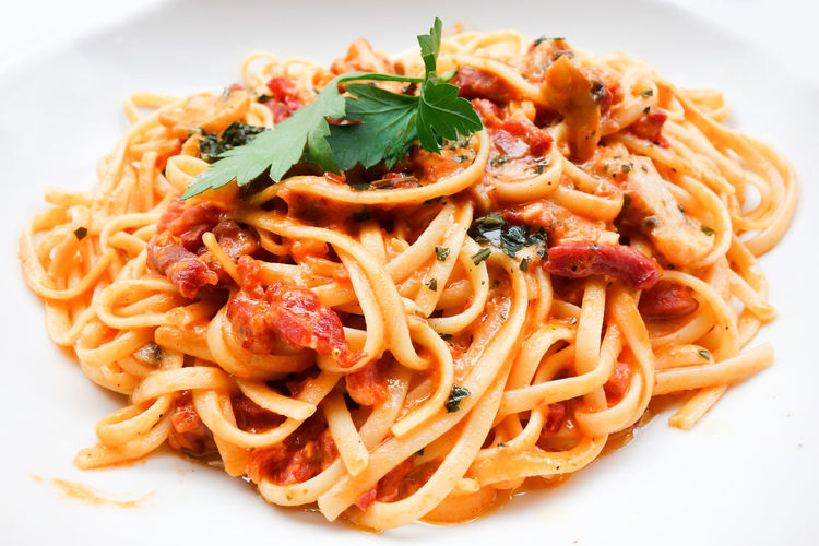 Close-up of spaghetti in tomato sauce