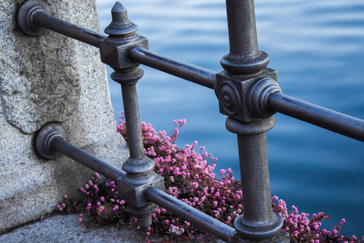 Close-Up Of Railing Against Lake