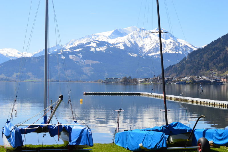 Austria Salzburger Land Mountain Transportation Nautical Vessel Water Mode Of Transportation Beauty In Nature Mountain Range Sky Scenics - Nature Nature Day Moored Lake Sailboat No People Non-urban Scene Travel Snow Outdoors Snowcapped Mountain