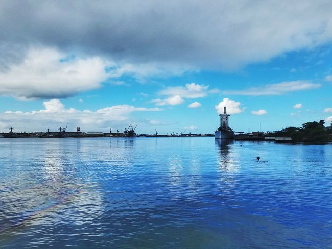Black tears in the foreground from the USS Arizona and USS Missouri in the background Pearl Harbor Pearl Harbor Memorial USS Missouri Uss Arizona Memorial Black Tears Dramatic Sky Travel Travel Destinations Hawaii History Reflection Sea