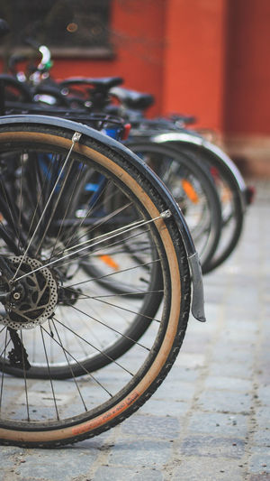 Close-up of bicycle parked on footpath