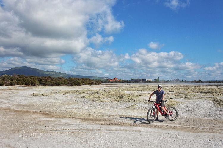 Man riding bicycle on land