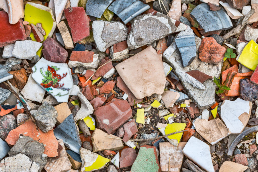 Broken multi-colored pieces of porcelain ceramics china Backgrounds Broken China Close-up Fragments Large Group Of Objects Multi Colored Potsherds Shards