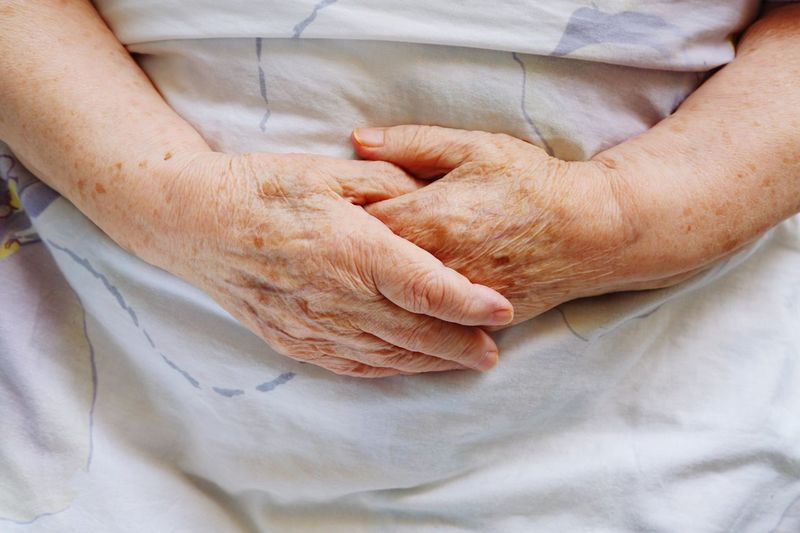 Hands of ancold woman in bed Senior Adult Human Body Part Human Hand Wrinkled Senior Women Indoors  Women Togetherness Grandmother Healthcare And Medicine Real People Human Skin Holding Close-up Only Women Men Adult Adults Only Patient