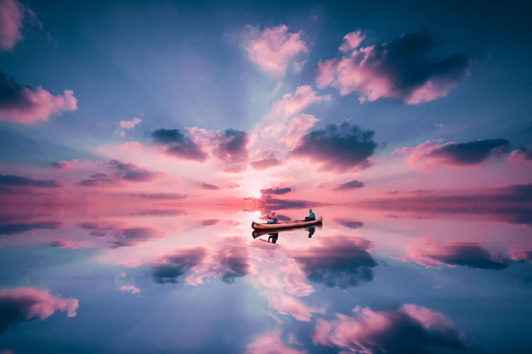 Life's finest Atmosphere Atmospheric Mood Boat Cloud Cloud - Sky Cloudscape Cloudy Dramatic Sky Glowing Journey Light Majestic Moody Sky Orange Color Outdoors Overcast Reflection Silhouette Sky Storm Cloud Sunset Water