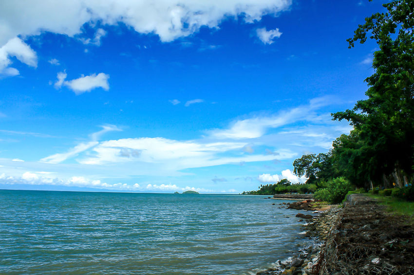 Sea View Clouds in the Sky on a Bright Day Beach Beauty In Nature Blue Cloud - Sky Day Horizon Horizon Over Water Idyllic Land Land With Sea Landscape Landscape Sea Landscapes Landscapes With Sea Nature No People Outdoors Plant Scenics - Nature Sea Sky Tranquil Scene Tranquility Tree Water