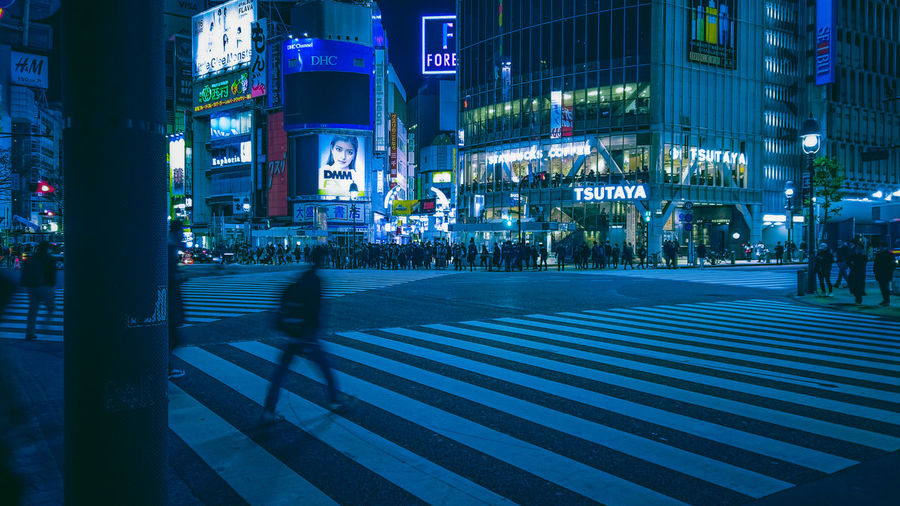 Cyberpunk Neo Tokyo Futuristic Technology Tech Urban Silhouette Motion Blurred Motion Zebra Crossing Cyber Security Algorithm Logic Atmospheric Mood Tokyo Japan Shibuya Shibuyascapes Shibuya Crossing People Neon Nightlife City Architecture Crosswalk Building Exterior Crossing Street Illuminated Sign Road Marking Road Built Structure Transportation Night Symbol City Life Marking Incidental People City Street Group Of People Outdoors Light My Best Photo 17.62°