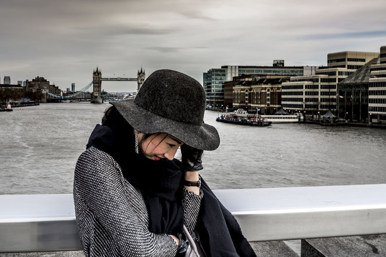 Windy walk in London Architecture Architecture Bridge City Cityscape Fashion Girl Hat London Outdoors People Tower Bridge  Travel Destinations Warm Clothing