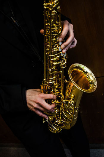Midsection Of Man Saxophone