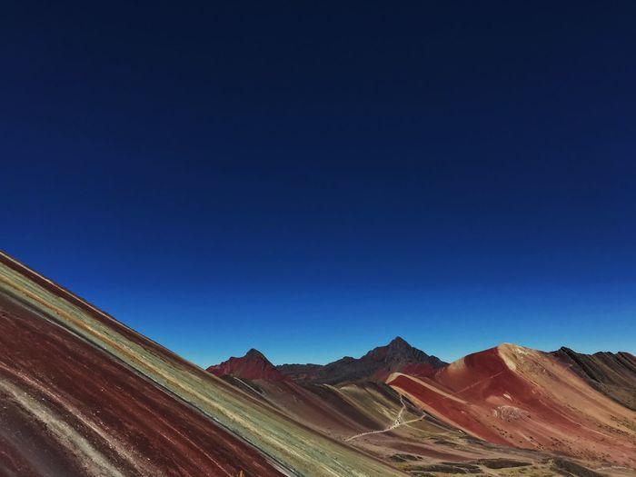 Rainbow mountain against clear blue sky