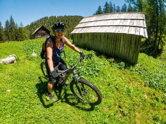 Woman on mountain bike, smiling, salzburg, austria