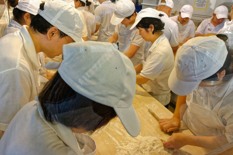 Chinese Food Taiwanese Food Adult Chef Chefs Commercial Kitchen Commercial Kitchens Day Din Tai Fung Dumpling Skin Dumplings Food Food And Drink Food Preparation Indoors  Kitchen Large Group Of People Men Occupation People Real People Standing Steamed Dumplings Teamwork Togetherness Women Working