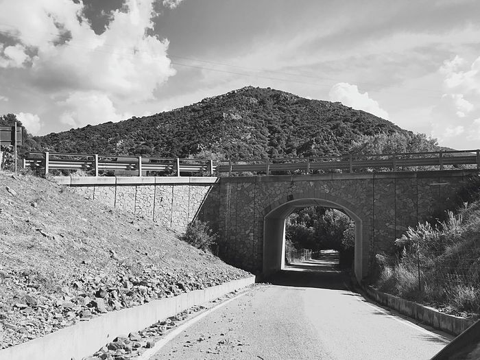 Streetphoto_bw Tunnel Passage Bridge Cloud - Sky Architecture Built Structure Nature Day Building Exterior Tree Travel Destinations Environment Arch No People Sunlight Outdoors