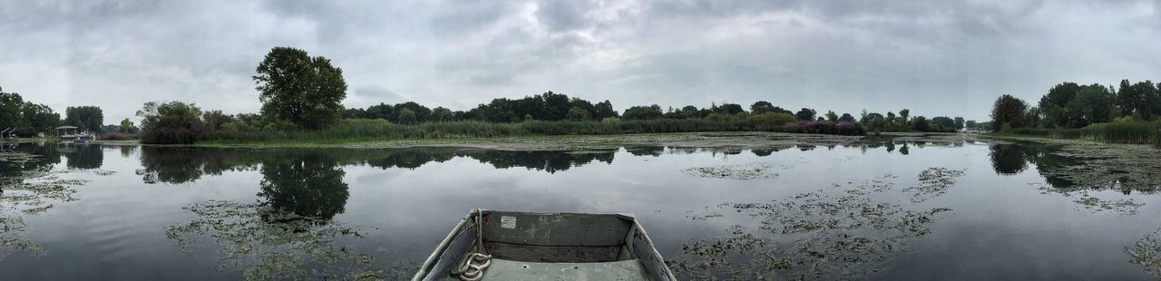 Panoramic shot of rowboat moored in canal
