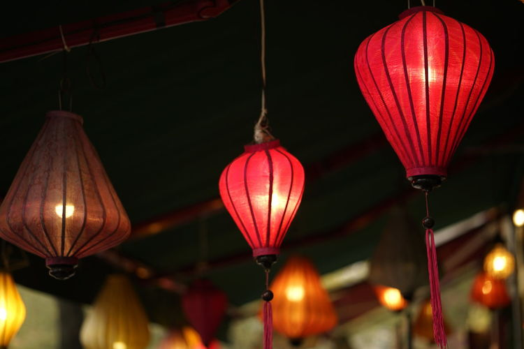 Lighting Equipment Hanging Illuminated Lantern No People Low Angle View Focus On Foreground Chinese Lantern Night Decoration Red Indoors  Celebration Electricity  Architecture Built Structure Glowing Light Chinese New Year Festival Chinese Lantern Festival