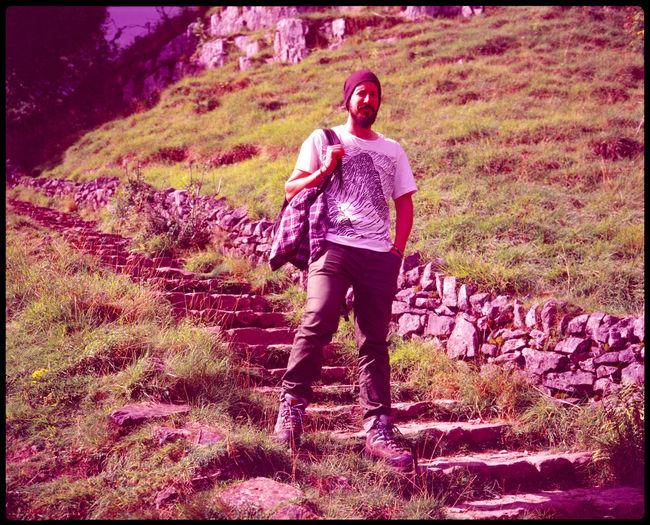 Full length portrait of man standing on land