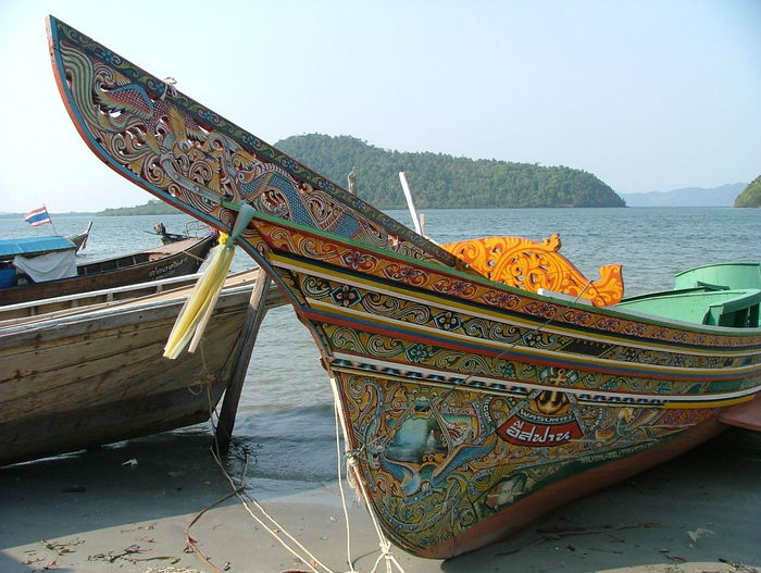 Blue Boat Clear Sky Colourful. Day Decorated Boat Fishing Boat. Moored Mountain Nautical Vessel No People Outdoors Sea Spotted In Thailand. Traditional Boat Traditional Decoration. Tranquility Water
