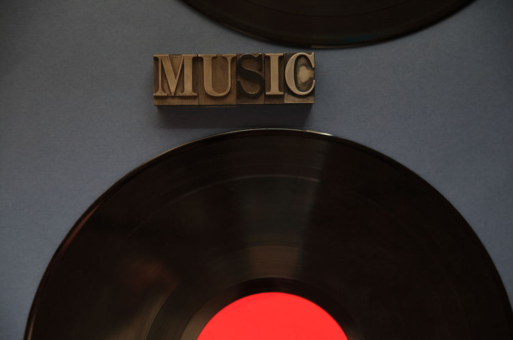 Music word with two vinyl records Audio Black Close-up Dark Background Day Entertainment Font Gray Indoors  Letters Metal Type Music Natural Light No People Overhead Recordings Recreational Pursuit Red Relaxing Text Space Textures Vinyl Records Word