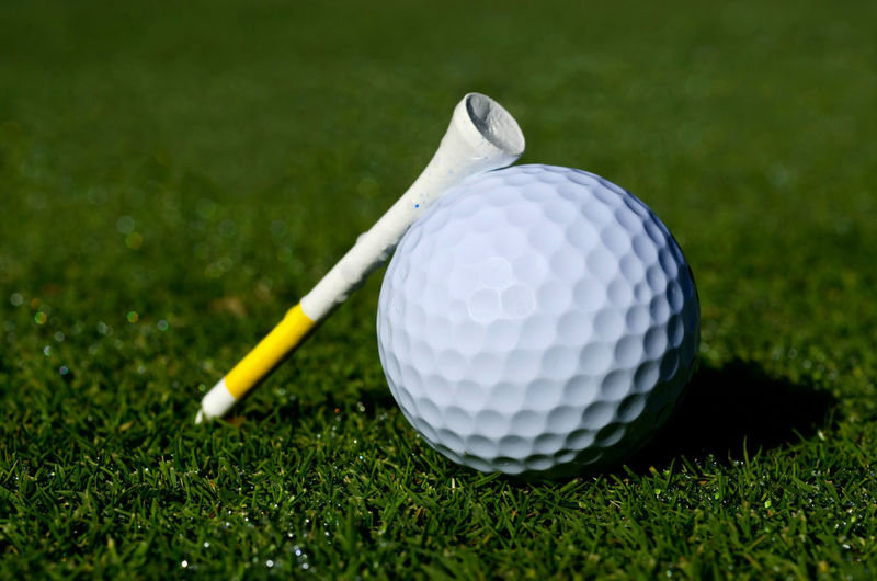 Close-Up Of Golf Ball And Tee On Grass