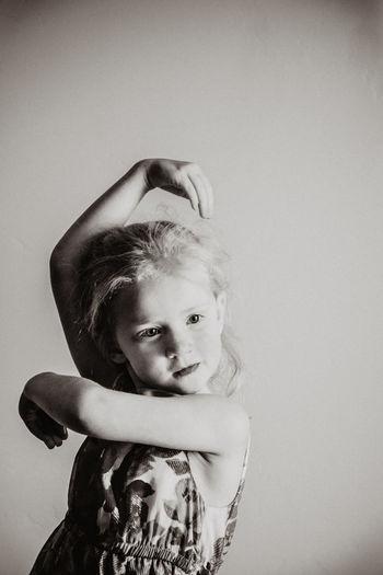 Girl dancing against wall
