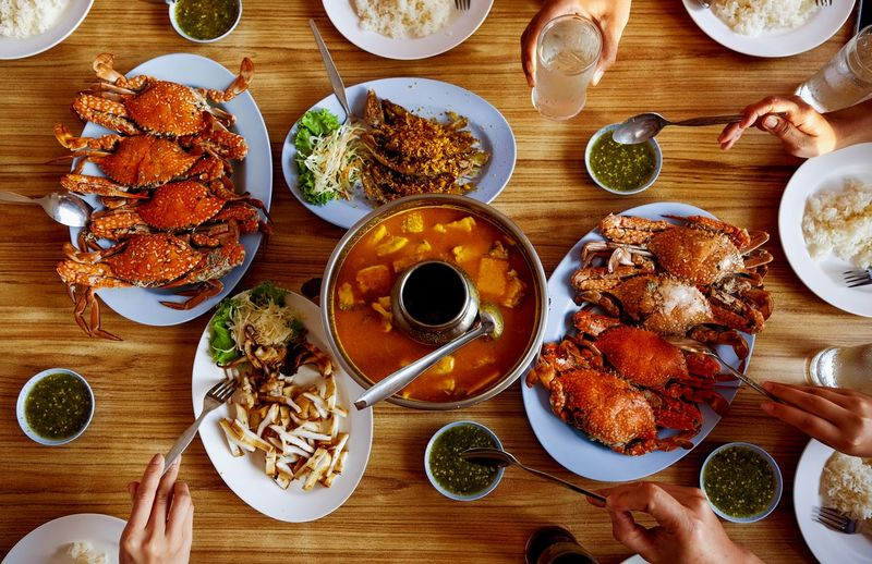 Top view. Thai food on table Plate Directly Above Table High Angle View Seafood Food And Drink Dim Sum Prepared Food Spring Roll Fried Rice Soy Sauce Sushi Japanese Food Salmon Food Styling Serving Dish Chinese Takeout Pancake Overhead View Rice Stir-fried Sashimi  Rice - Food Staple Caviar Salmon - Seafood Chopsticks Served Chinese Food Bean Sprout Dumpling