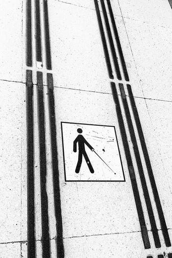 High angle view of arrow sign on wall