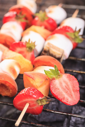 close up shut of marshmallows and fruits on the grill Apricot Marshmallows Apricot, Banana, Barbecue, Cooking, Dessert, Dinner, Eating, Fire, Flames, Food, Fruit, Gourmet, Grill, Healthy, Heat, Outdoors, Party, Peach, Preparation, Prepared, Summer, Sweet Berry Fruit Close-up Day Focus On Foreground Food Food And Drink Freshness Fruit Fruits Grill Healthy Eating High Angle View Indoors  Meat No People Red Ripe Still Life Strawberry Tomato Vegetable Wellbeing