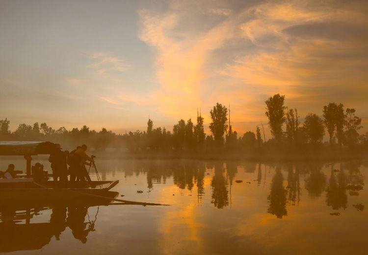 Reflection Sunrise Sunrise_Collection Xochimilco Mexico City Canales Tree Water Sky Nature Outdoors Silhouette Tranquility Cloud - Sky Beauty In Nature Tranquil Scene Lake Scenics Nautical Vessel Real People Day