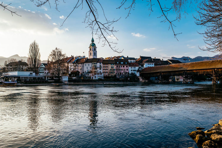 River against buildings in town