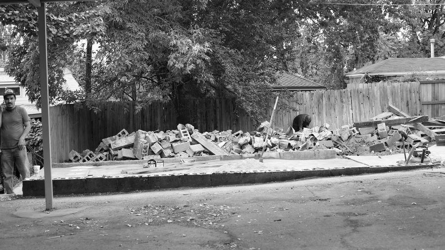 Taken in the summer of 2015 right after a neighboring building had been brought to the ground. I rather liked the building that was there. Oh well. Things change. Black And White Bricks Building Removal Cinder Blocks Construction Site Day Debris Destruction Men Nature Outdoors Rocks Rubble Street Photography Taken By M. Leith The Street Photographer - 2017 EyeEm Awards Live For The Story