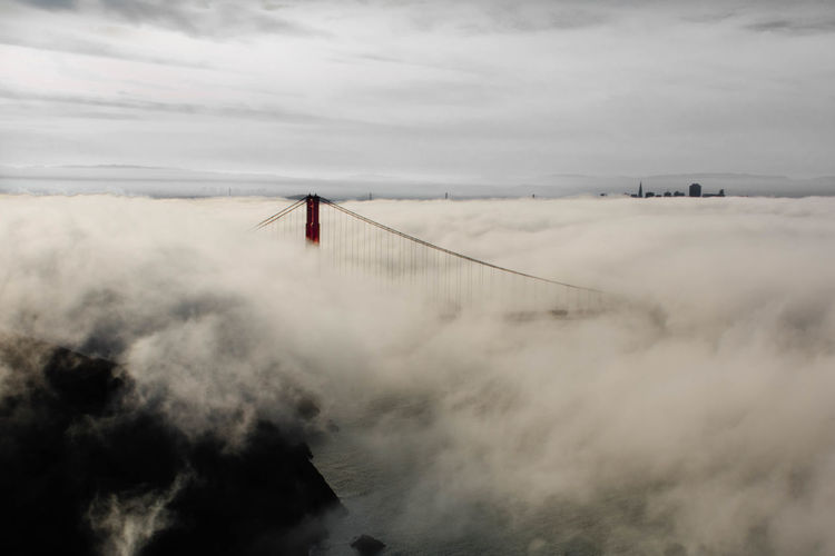 Rising Above the Fog Atmospheric Mood Bridge Bridge - Man Made Structure Downtown GoldenGateBridge Moody Ocean Outdoors Power In Nature Suspension Bridge Water Weather