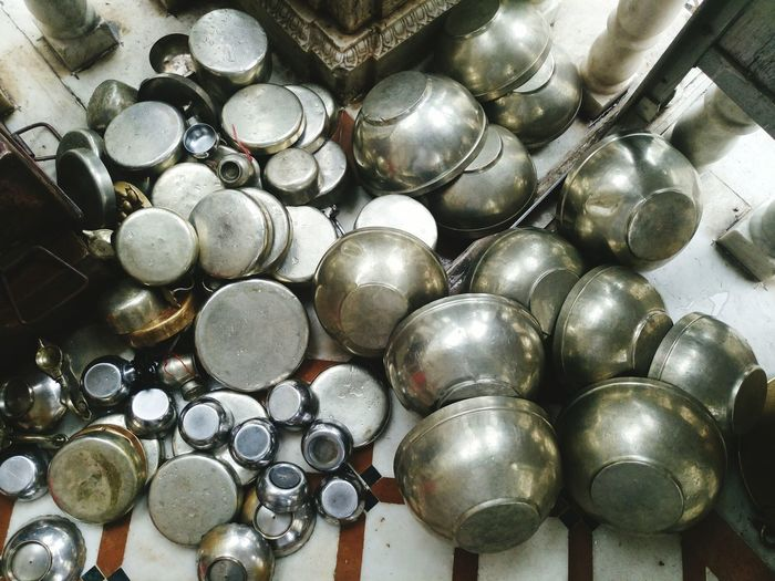 High angle view of utensils on tiled floor