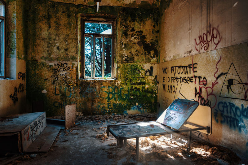 Abandoned Window Graffiti Indoors  Decline Damaged No People Deterioration Obsolete Architecture Run-down Messy Old Bad Condition Dirt Building Day Absence Destruction Furniture Ruined Dirty Mental Hospital