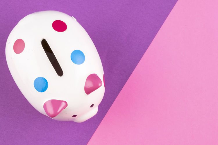 empty piggy bank on pastel color background. Pink Color Indoors  No People Art And Craft Colored Background Still Life Close-up Copy Space Studio Shot High Angle View Single Object White Color Purple Wall - Building Feature Arts Culture And Entertainment Representation Table Creativity Blue Pink Background