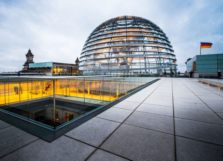 The iconic glass copula of the German Reichstag building designed by Sir Norman foster. Photographed at sunset. Baroque Revival Architecture Berlin Berlin Photography Democracy German Flag Platz Der Republik ReichstagBuilding Tourist Attraction  Twilight Architecture Building Exterior Copula Dome German Reichstag Germanlandmarks Germany Modern No People Outdoors Paul Wallot Plazza Politics And Government Reichstag Sunset Tourist Destination