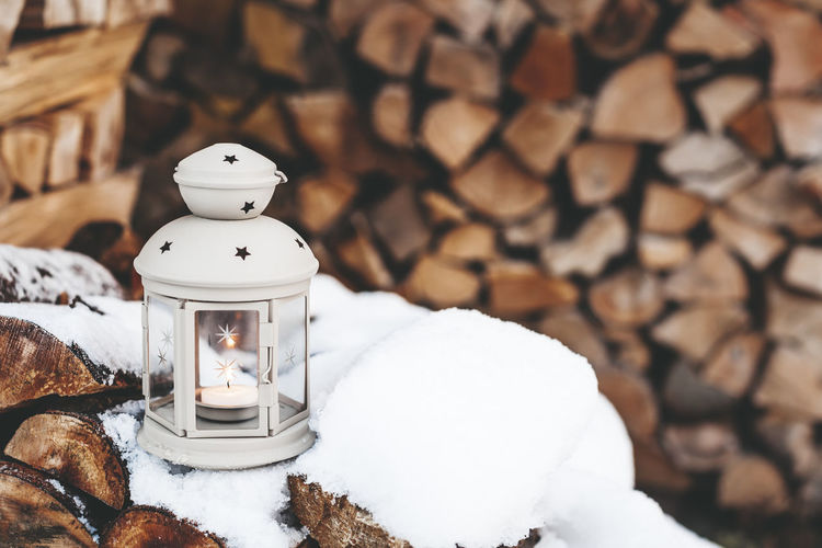 Winter Deco Lantern on wooden background in snow outdoor Art And Craft Candle Close-up Cold Temperature Creativity Decoration Focus On Foreground Human Representation Indoors  Lighting Equipment Nature No People Representation Snow Snowman Still Life White Color Winter Wood - Material