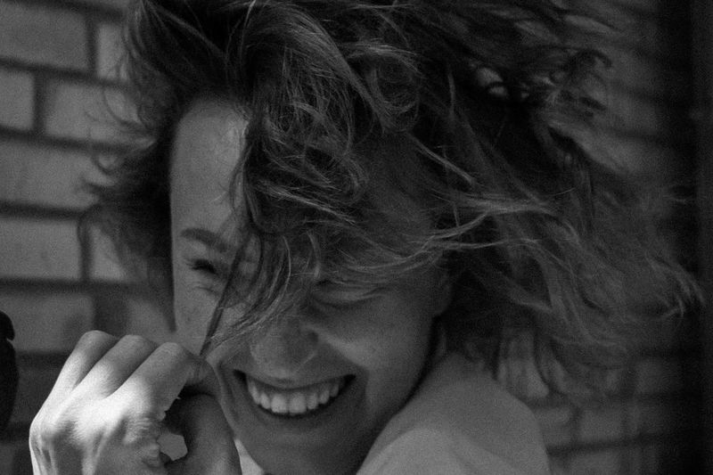 Close-up of smiling woman with tousled hair