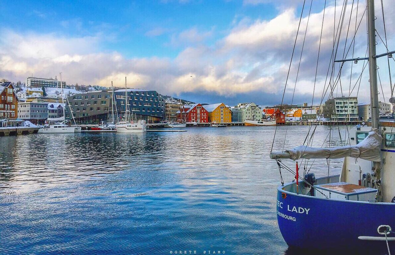 nautical vessel, transportation, mode of transport, sky, moored, water, cloud - sky, no people, architecture, building exterior, built structure, harbor, outdoors, mast, sailboat, day, sea, blue, nature, city, sailing ship